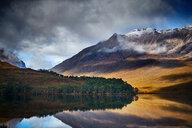 Tranquil mountain landscape mirror imaged in loch, Achnasheen, Scottish Highlands, Scotland - CUF50083