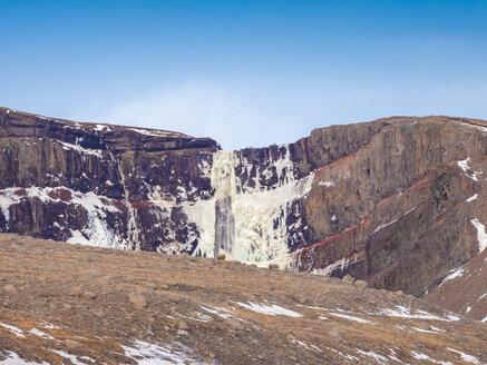 Iceland, Hengifoss waterfall frozen in winter - TAMF01266