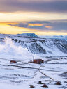 Iceland, snowy landscape with Krafla thermal power plant in winter by sunrise - TAMF01269