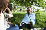Women having fun at a picnic in park - IGGF00987