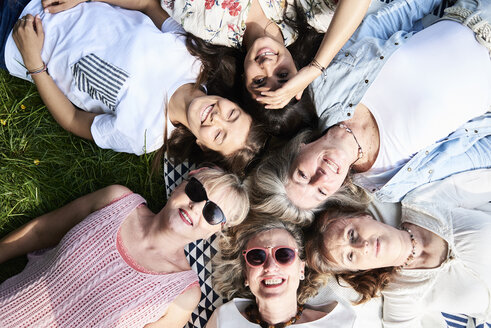 Top view of happy group of women lying in a meadow - IGGF01014