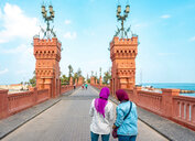 Two female tourists taking photograph on Montaza palace bridge, Alexandria, Egypt - CUF50146