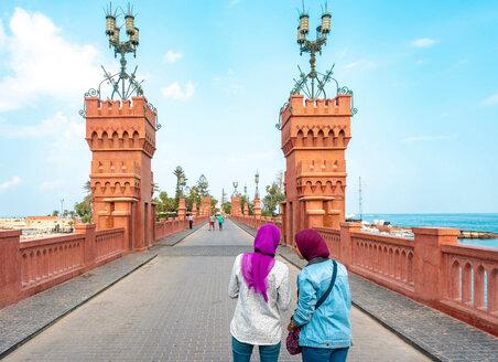 Two female tourists taking photograph on Montaza palace bridge, Alexandria, Egypt - CUF50146