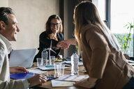 Businessman and businesswomen having meeting in office - CUF50230