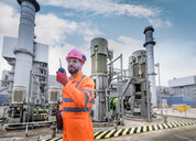 Composite image of worker using walkie talkie in powerstation - CUF50263