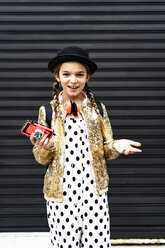 Portrait of smiling girl with smartphone wearing hat, golden sequin jacket and polka dot jumpsuit - ERRF00890