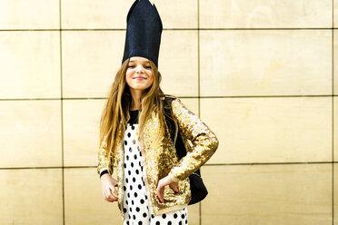 Portrait of smiling girl wearing golden sequin jacket, polka dot jumpsuit and black crown - ERRF00917
