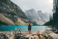 Woman enjoying view, Moraine Lake, Banff, Canada - ISF21095