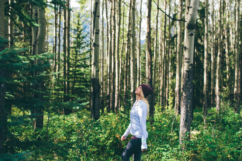 Woman enjoying forest, Banff, Canada - ISF21107