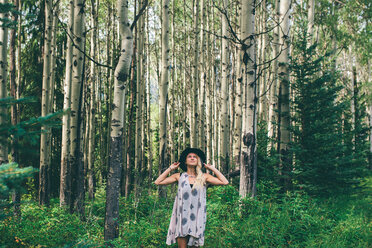Woman enjoying forest, Banff, Canada - ISF21110