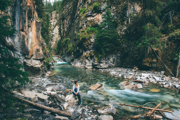 Woman enjoying view, Johnston Canyon, Banff, Canada - ISF21113