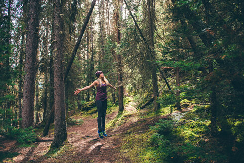 Hiker enjoying forest, Johnston Canyon trail, Banff, Canada - ISF21116