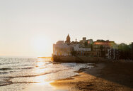 Sunset over beach, Sitges, Catalonia, Spain - CUF50303
