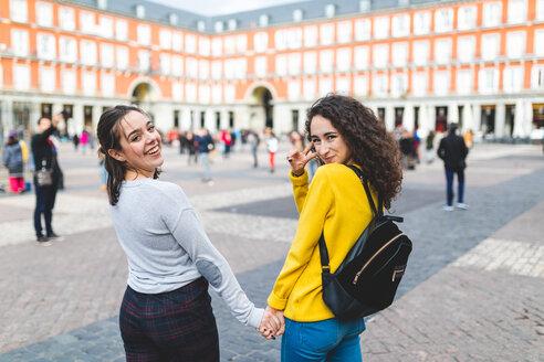 Girlfriends exploring city, Madrid, Spain - CUF50315