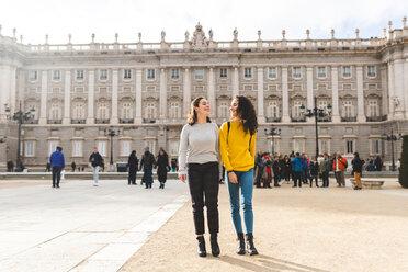 Girlfriends exploring city, Madrid, Spain - CUF50318