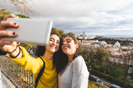 Girlfriends taking selfie in city, Madrid, Spain - CUF50321