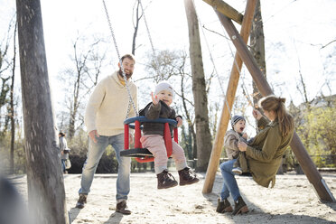 Happy family on playground - MAEF12841