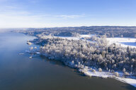 Germany, Bavaria, Sankt Heinrich, snowy forest at Lake Starnberg, aerial view - SIEF08572