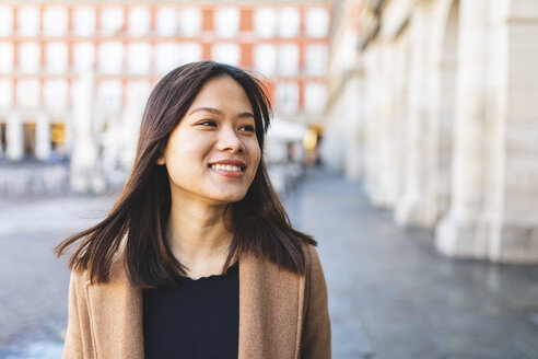Spain, Madrid, portrait of smiling young woman at Plaza Mayor - WPEF01483