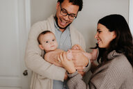 Couple with baby daughter in diapers - ISF21128