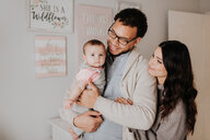 Couple with baby daughter in baby's room - ISF21137