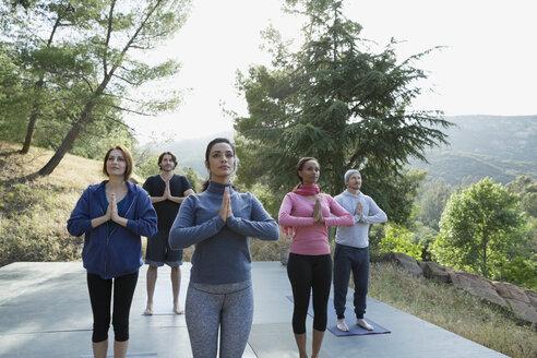 People practicing yoga on deck - HEROF35678