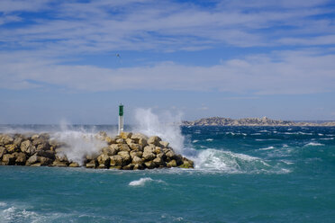 France, Marseille, Place Florence Arthaud, La Madrague, strong waves at a jetty with lighthouse - LBF02536