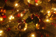 Christmas tree with Christmas baubles and light chains, partial view - JTF01213