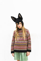 Portrait of displeased girl in bat costume in front of white wall - ERRF00982