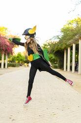 Girl in super heroine costume jumping - ERRF01018