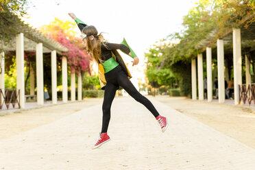 Girl in super heroine costume jumping - ERRF01021