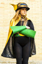 Girl in super heroine costume posing at brick wall - ERRF01030