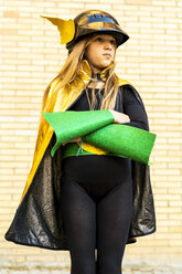 Girl in super heroine costume posing at brick wall - ERRF01030