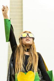 Girl posing in super heroine costume clenching fist - ERRF01033