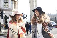 UK, London, two happy women in the city near Big Ben - IGGF01110