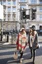 UK, London, two women in the city crossing a street - IGGF01119