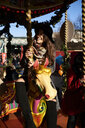 Happy woman having fun on a carousel - IGGF01143