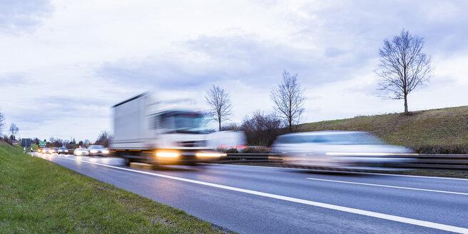 Germany, Badenwurttemberg, Truck overhauling car on federal highway - WDF05236