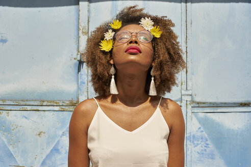 Portrait of young woman with red lips wearing glasses and flowers in her hair looking up - VEGF00005