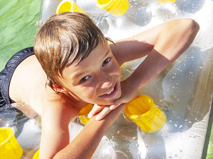 Portrait of boy in water on airbed - WWF05044