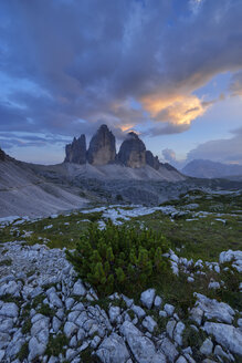 Italy, Sexten Dolomites, Tre Cime di Lavaredo at sunset, Nature Park Tre Cime, Unesco World Heritage Natural Site - RUEF02136