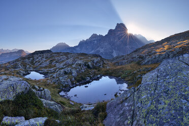 Italy, Dolomites, Pale di San Martino Mountain group with mountain peak Cimon della Pala and two small mountain lakes at sunrise - RUEF02160