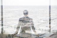 Digital composite businessman looking over industrial buildings - HEROF35810
