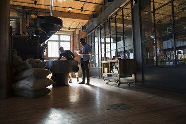 Coffee roasters working at coffee roasting machine - HEROF35831