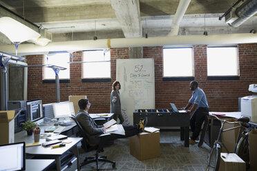Entrepreneurs brainstorming in new office - HEROF35858