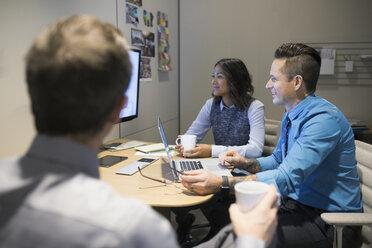 Business people watching monitor in meeting - HEROF35921