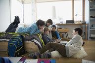 Boys hanging out using digital tablet in bedroom - HEROF35936