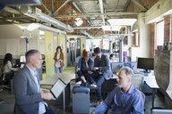 Business people working in open plan office - HEROF35957
