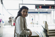 Portrait confident woman at train station - HEROF36062