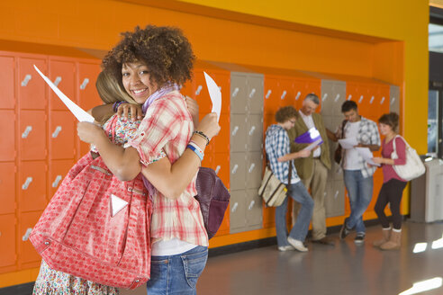 Excited students hugging after receiving good news about test results - JUIF00863